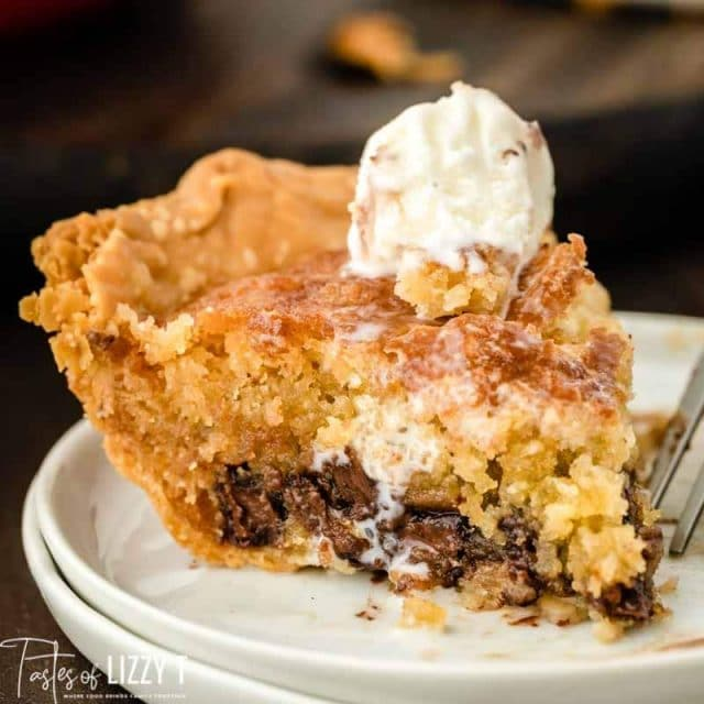slice of cookie pie on a plate with ice cream