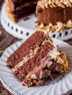 a slice of reese's peanut butter cake on a plate