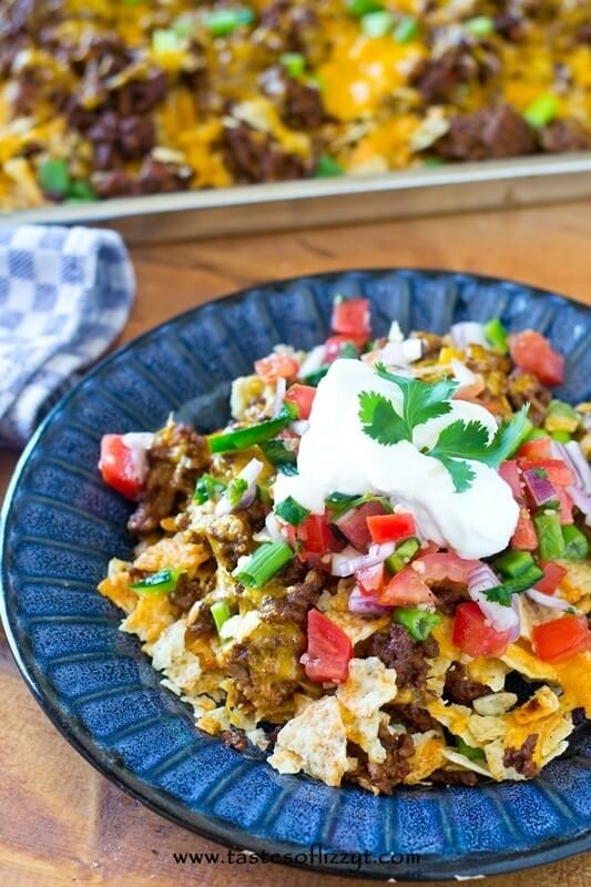 Use crushed tortilla chips and leftover taco meat for this simple Tortilla Chip Mexican Pizza. Serve with fresh salsa and a dollop of sour cream for a quick family meal.
