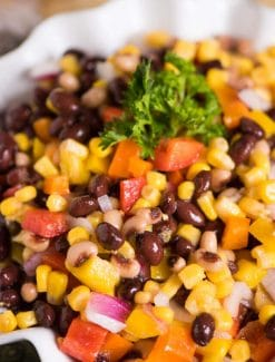 Hillbilly Caviar...an easy pepper, bean, onion, corn side dish that is served with tortilla chips. This is make-ahead recipe great for summer picnics!