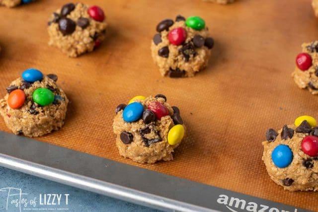 monster cookie dough balls on a baking mat