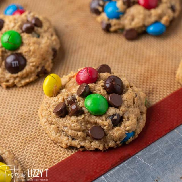 loaded peanut butter M&M monster cookies on a baking sheet