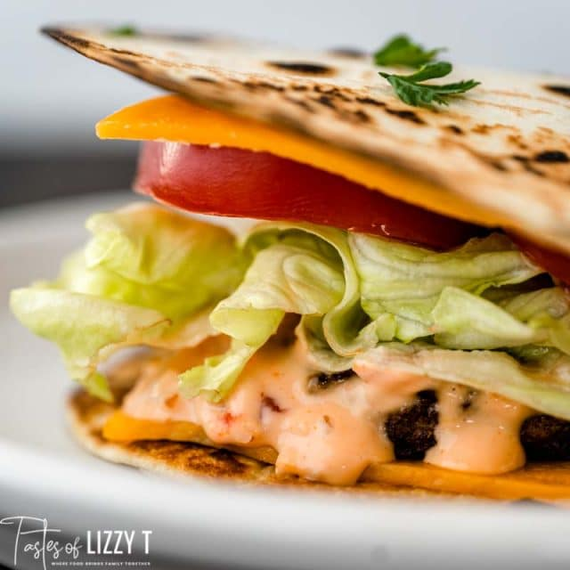 loaded quesadilla burger on a plate