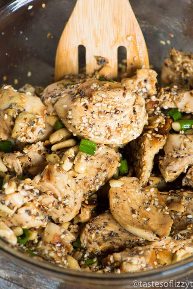 chicken and toasted seeds and nuts in a mixing bowl