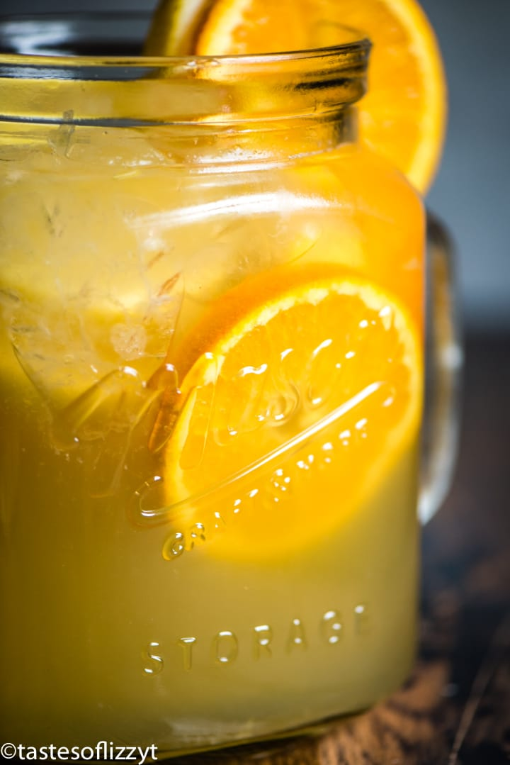 A glass of orange juice, with Punch and Fruit