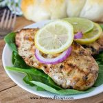 lemon lime garlic chicken dinner on a plate