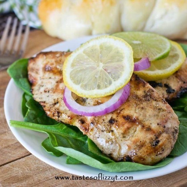 lemon lime garlic chicken dinner on a plate