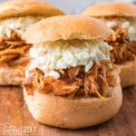 Slow Cooker BBQ Chicken on a bun with coleslaw