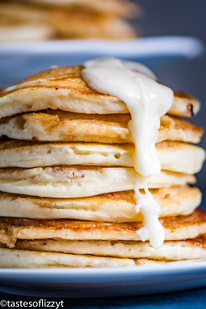 a stack of pancakes with dripping glaze