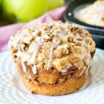 Big, Bakery style Apple Butter Streusel Muffins have a layer of apple butter and crumb streusel, with an apple cider glaze on top.