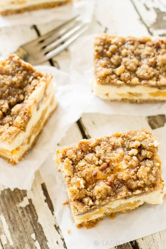 Caramel Apple Cheesecake Bars with a sweet brown sugar streusel baked on top.  You love the swirls of caramel and apple pie filling inside.