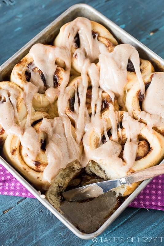 Gooey, homemade Apple Butter Cinnamon Rolls are filled with sweetened apple butter, baked to a soft, golden brown and spread with cinnamon cream cheese frosting.