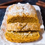 Easy pumpkin bread recipe with powdered sugar sprinkled on top