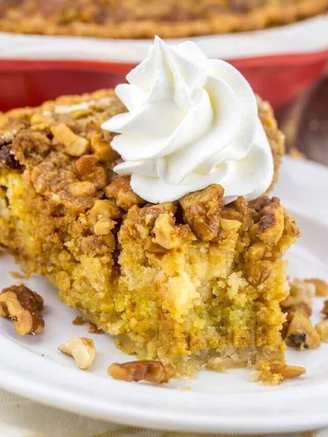 slice of pumpkin crumb pie topped with whipped cream