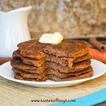 carrot cake pancakes with butter and a bite out of it