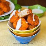 homemade buffalo chicken nuggets in a bowl with ranch drizzle