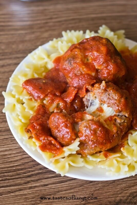 large homemade Italian meatballs stuffed with mozzarella cheese and covered with pepperoni sauce