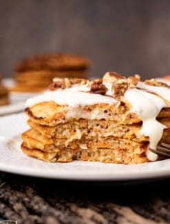 a plate of half eaten carrot cake pancakes