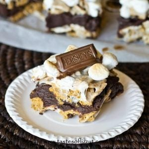 S'more Brownie Batter Bars. Gooey bars with brownie batter sandwiched between marshmallow covered golden grahams and toasted marshmallows on top!