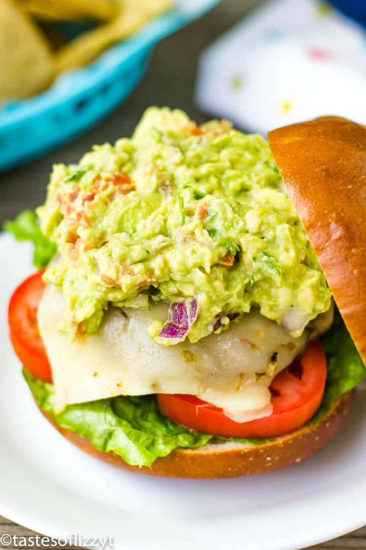 A close up of a sandwich with guacamole