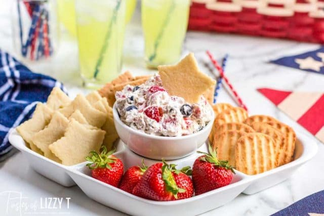 platter with strawberries, cookies and triple berry fruit dip