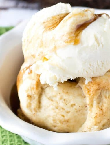 Amish Apple Dumplings served with ice cream and brown sugar syrup