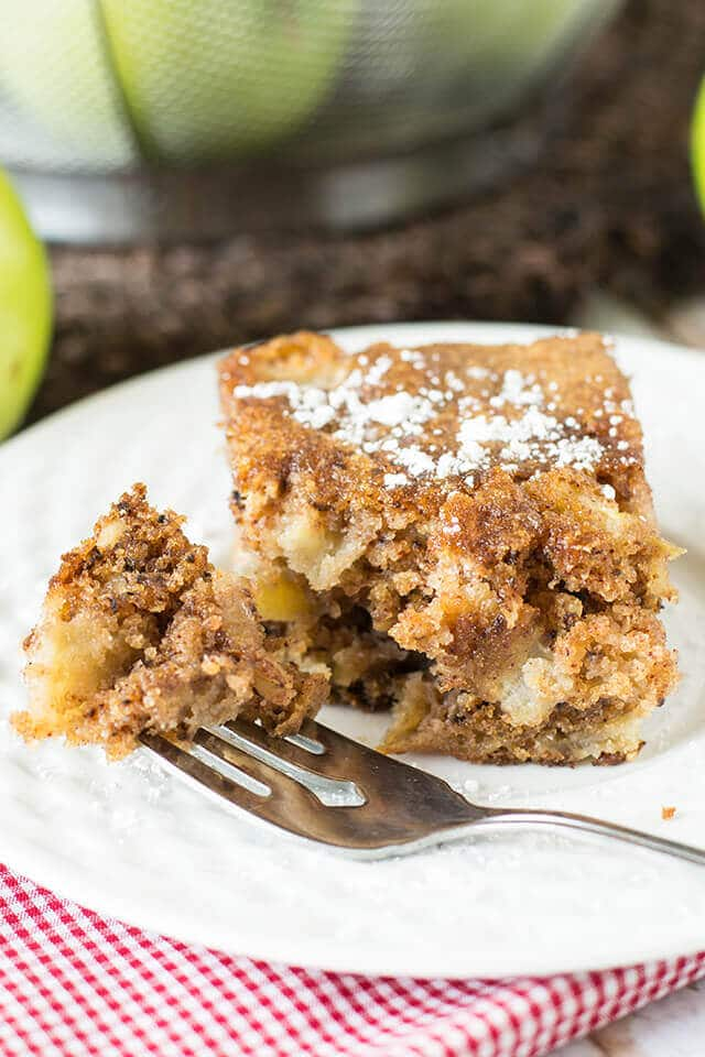 slice of apple walnut cake with a forkful next to it