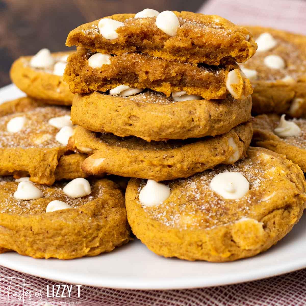 plate of pumpkin cookies, one broken in half