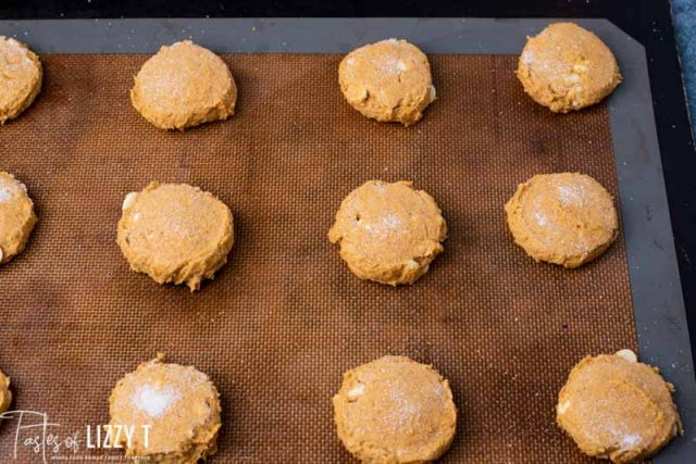 unbaked cookies on a baking sheet