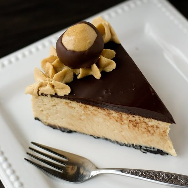 peanut butter cheesecake on a plate with a fork
