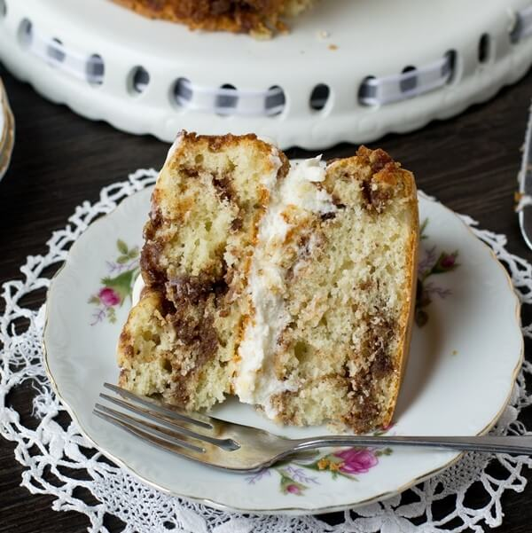 cream filled cinnamon cake on a plate