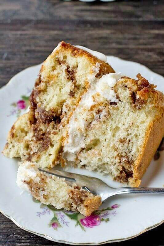 cinnamon layered coffee cake on a plate with a fork