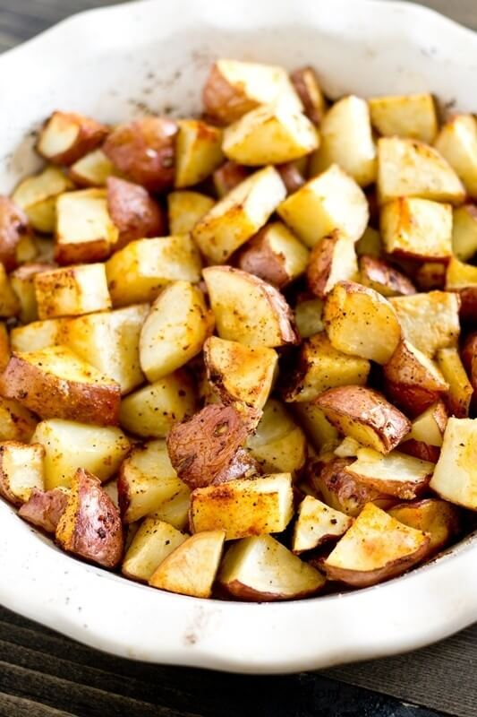 Simply seasoned, easy oven roasted potatoes make the ideal side dish for a meat and potatoes dinner. A high baking temperature makes the potatoes sizzle and brown nicely.