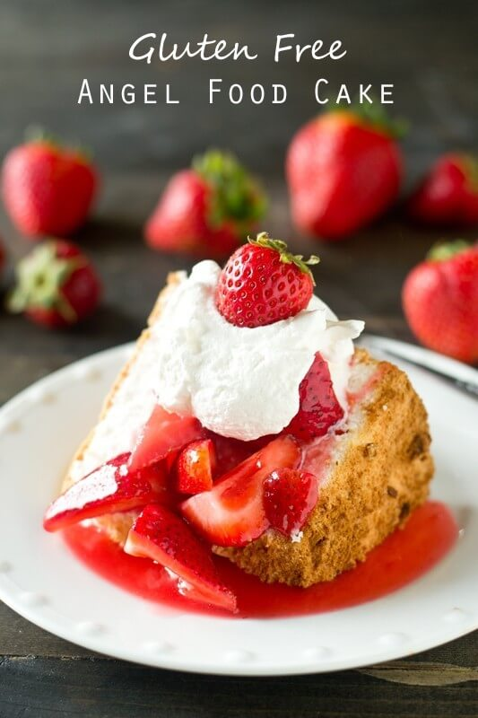 Gluten Free Angel Food Cake topped with strawberries and whipped cream