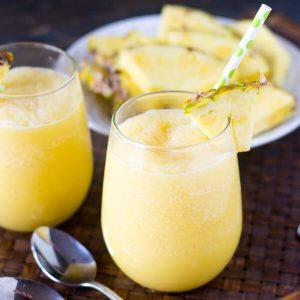 Sweet, creamy and tangy, this Pineapple Cream Tropical Smoothie with pineapple and a hint of orange is sure to refresh you on a hot summer day. It's dairy free and has no added sugar!