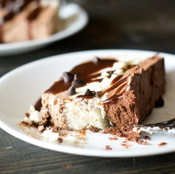 Three layers of whipped chocolate ganache are frozen together in this Triple Chocolate Frozen Dessert. This frosty dessert is creamy and smooth with an intense chocolate flavor.