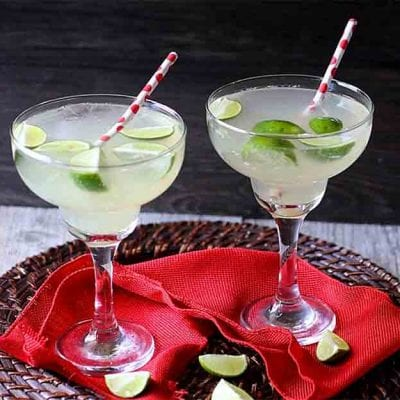 The spicy homemade Ginger Syrup will entice you. The perky pucker of limes will bind you. You will never put down this effervescent Ginger Lime Soda!