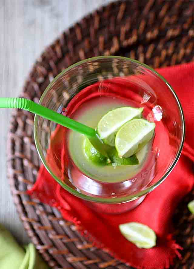 glass with limes in it