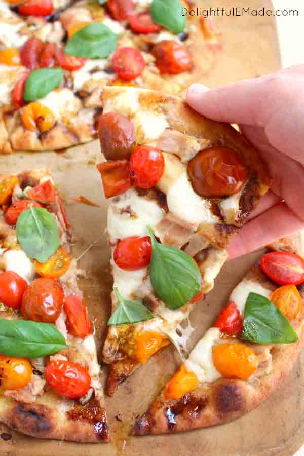 slice of caprese pizza
