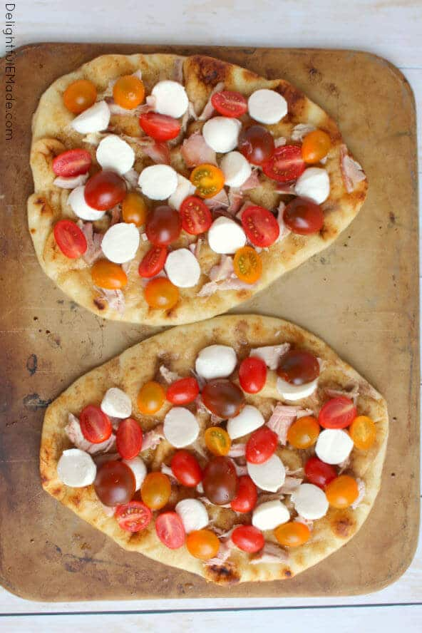 Grilled Chicken Caprese Pizza Made On Naan Bread And Topped With Fresh Tomatoes And Mozzarella