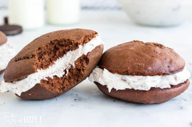 two whoopie pies, one with a bite out of it