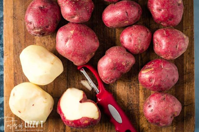 red potatoes on a cutting board