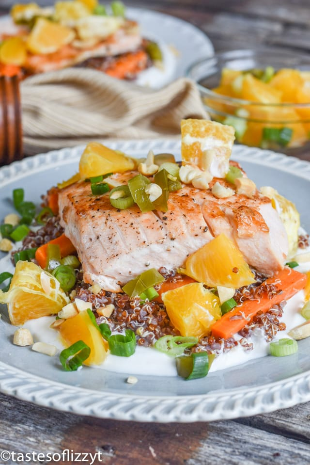 A plate of food on a table, with salmon and Mediterranean diet