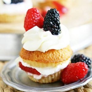 Sweet honey cornbread cupcakes turned into the best shortcakes you will ever have. Triple sugared berries piled high with fluffy clouds of homemade whipped cream. Summer was always meant to be this sweet.