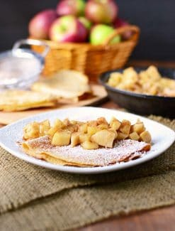 Whole wheat apple crepes stuffed with vanilla yogurt crepe filling and topped with cinnamon apples