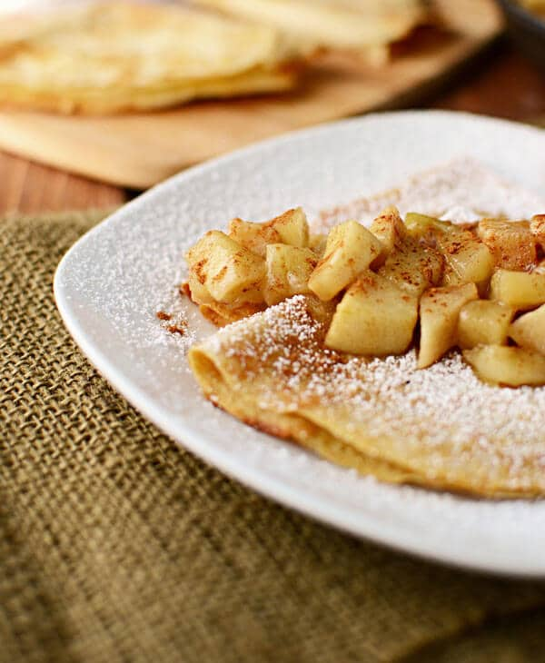 Whole wheat apple cider crepes stuffed with vanilla yogurt and topped with apple pie filling. A delicious, simple breakfast idea.