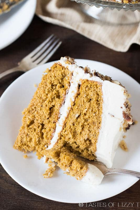 slice of pumpkin layer cake with cream cheese frosting