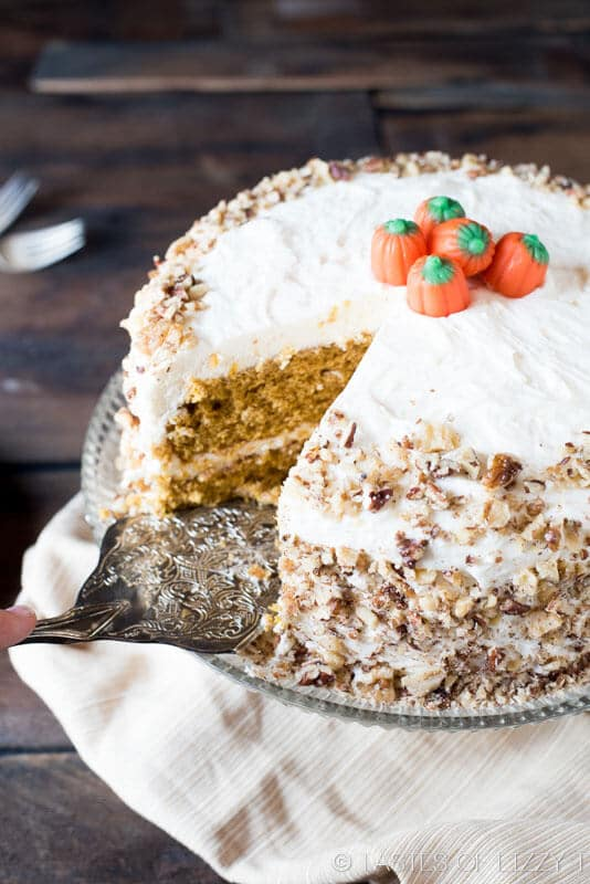 A homemade, Amish recipe for layered Pumpkin Spice Cake. Topped with cream cheese frosting and chopped nuts.