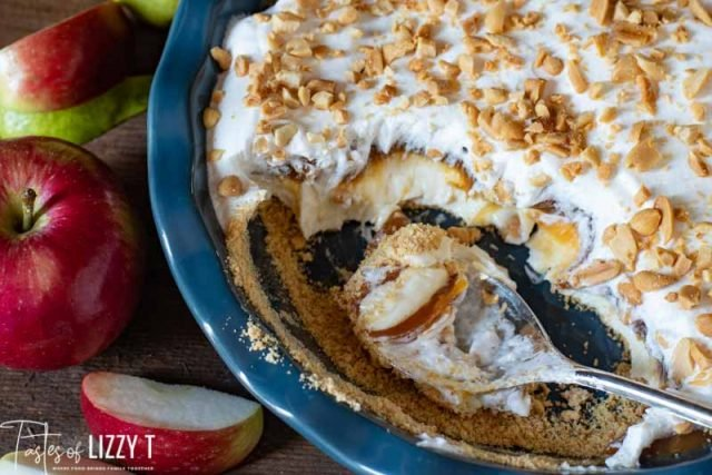 caramel apple dip in a pie plate with scoop out