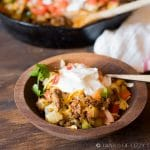 golden brown skillet Mexican potatoes topped with sour cream